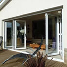 uPVC bifold doors opening out onto decking