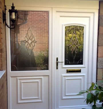 uPVC front door in white with decorative glass