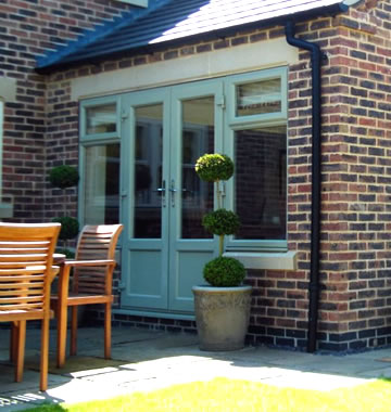 Chartwell green french doors on a conservatory