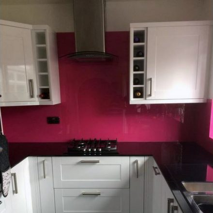 Pink splashbacks black sparkle glass work tops