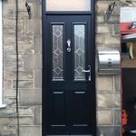 Black entrance door installation