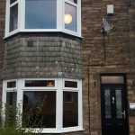 Two white uPVC bow windows