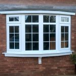White uPVC bow window installation