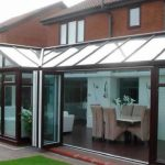 rosewood conservatory with bi-folding doors in Yorkshire